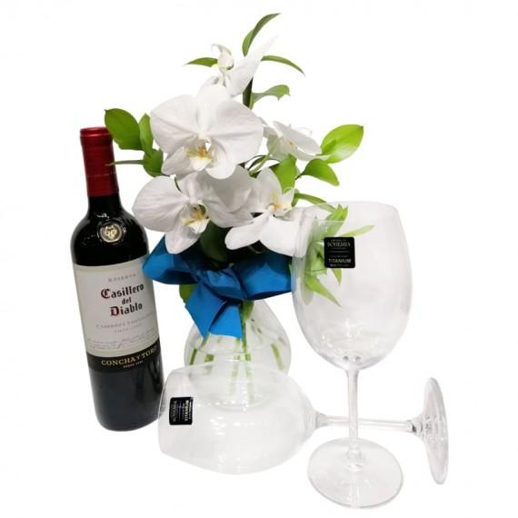 Arrangement with White Orchids, Casillero del Diablo Wine and Glasses