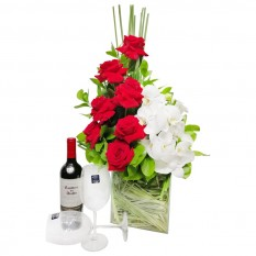 Arrangement with Colombian Roses, White Orchids, Wine and Glasses