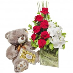 Arrangement with Colombian Roses and Orchids, Teddy Bear and Ferrero Rocher Chocolate